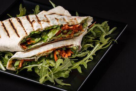 Vegetarian pita with arugula and carrots.