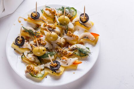 Salted herring on skewers with cheese and olives Stok Fotoğraf