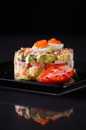 Round salad made of red fish potato and avocado. Stok Fotoğraf