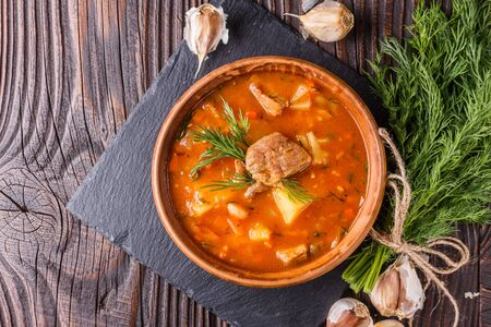 Chanahi a traditional Georgian meat stew in a bowl on stoyn board. Stok Fotoğraf