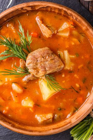 Chanahi a traditional Georgian meat stew in a bowl on stony board.