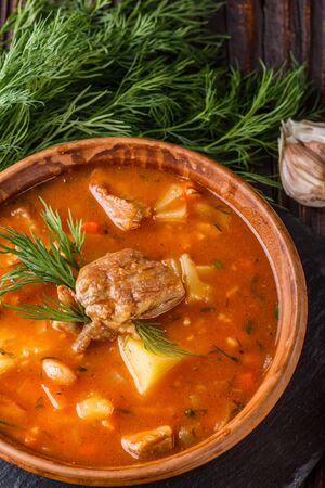 Chanahi a traditional Georgian meat stew in a bowl on stoyn board.