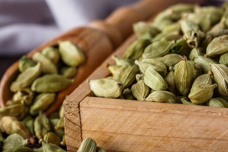 fragrant green cardamom on a wooden rustic background.