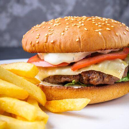 traditional american burger on a gray stone background. Zdjęcie Seryjne