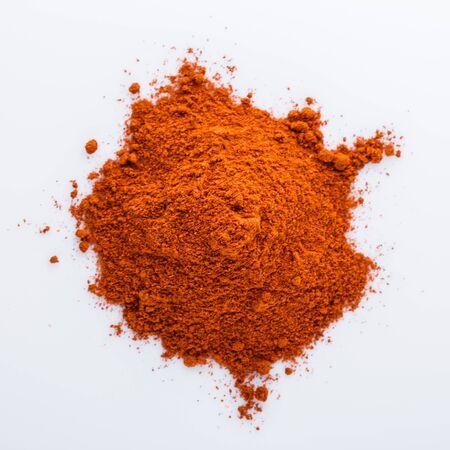 aromatic spicy chili powder on a white background. Stockfoto