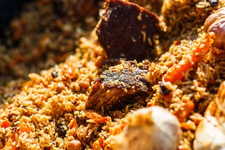 pilaf at the counter of the street food festival. Foto de archivo