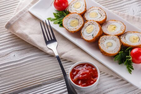 Scotch egg meat balls on rustic wooden background.