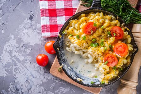 delicious pasta and cheese casserole in a cast iron skillet.