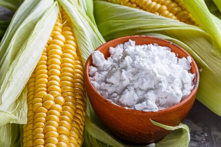 corn starch on a dark stone background. Banque d'images