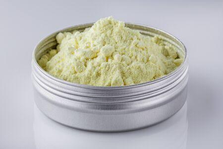 purified sulfur powder on a white acrylic background. Reklamní fotografie