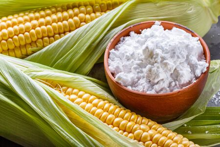 corn starch on a dark stone background.
