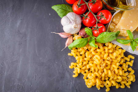 concept of traditional italian pasta with tomatoes and basil.