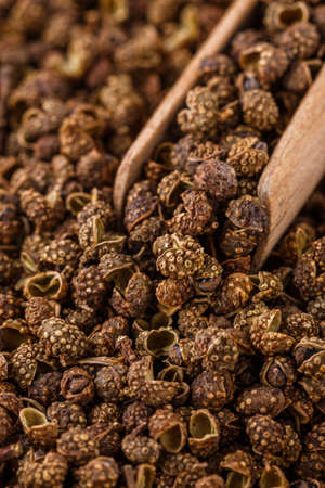 fragrant Sichuan pepper on white acrylic background.