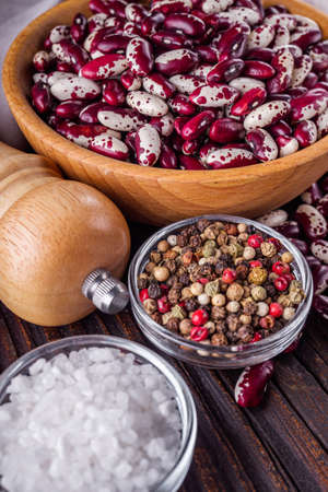 Fresh organic natural beans on wooden rustic background.
