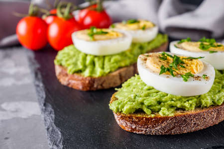 tasty and nutritious avocado sandwich and boiled egg.
