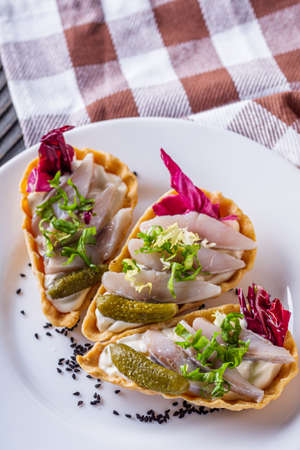 delicious snack tartlets on rustic wooden background Stock fotó