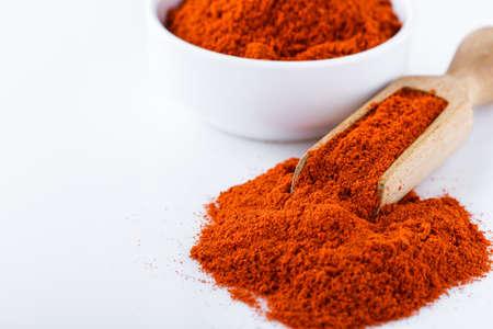 fragrant ground paprika on a white acrylic background Stock fotó