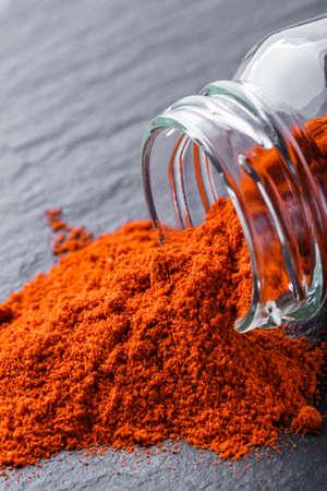 aromatic ground paprika on a dark stone background