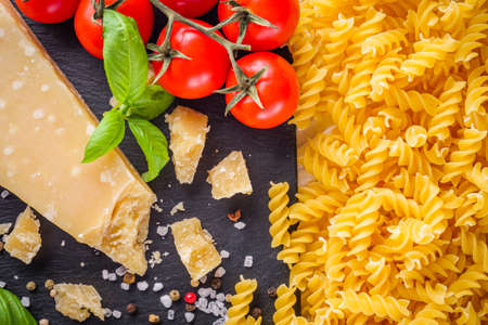 concept of traditional italian pasta with tomatoes and basil