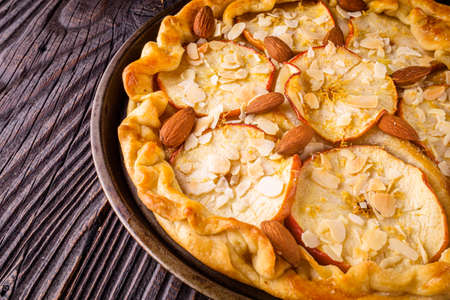crispy apple galette with almonds on rustic wooden background Stock fotó