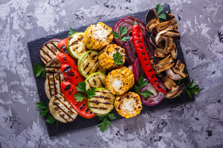 delicious fresh grilled vegetables on a stone plate