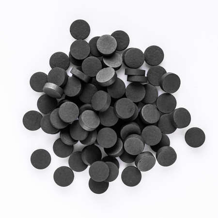 activated carbon on a white acrylic background