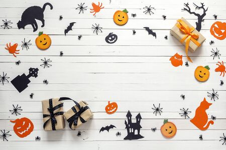 Background with Halloween decoration on white wooden table. Blank space for text. Festive; concept.