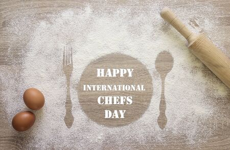 International Chef day greeting card. Prints of dish, fork and spoon in the flour with uncooked eggs and rolling pin. Top view mock up.