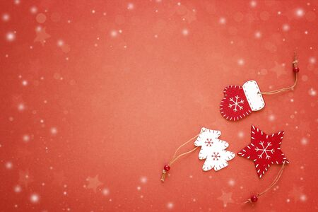 Red background with Christmas decorations. Space for text. Top view.
