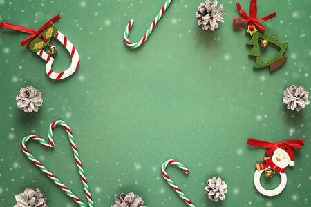 Green background with Christmas decorations and copy space. Top view, flat lay. Фото со стока