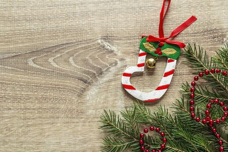 Fir branches and Christmas decorations on wooden background. Space for text. Top view.