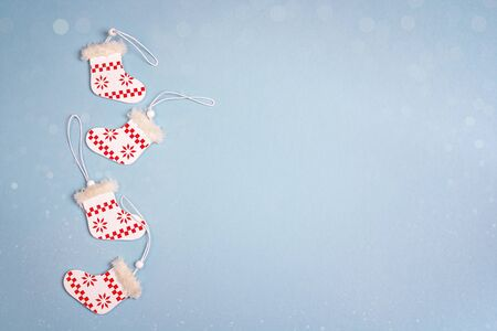Blue background with Christmas decorations. Space for text. Top view.