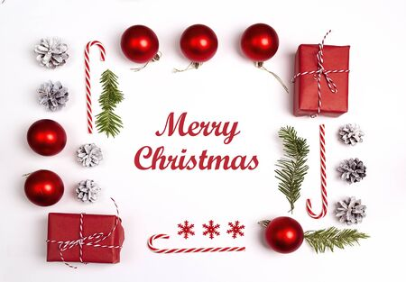 Christmas greeting message with decorations and gifts on white background. Flat Lay. Stock fotó
