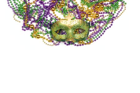 Festive Carnival mask and beads on a white background. Space for text.