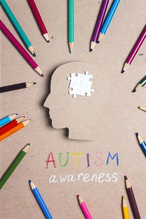 Autism Awareness Day concept with puzzles brain symbol and color pencils. Autism Spectrum Disorder (ASD) concept. 写真素材
