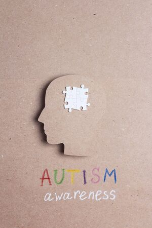 Autism Awareness Day concept with puzzles brain symbol. Autism Spectrum Disorder (ASD) concept.