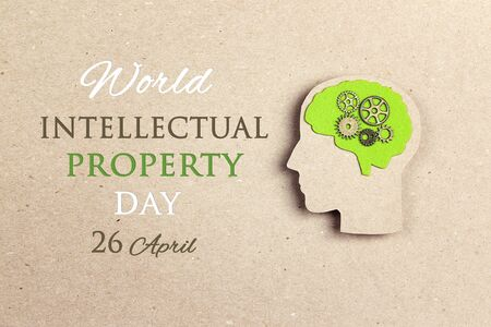 World Intellectual Property Day, april 26. Poster with silhouette human head with green brain and gears.