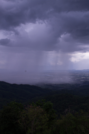 nimbus: Rain clouds are moving along the mountain.