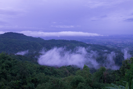 nimbus: Clouds float over the mountains after rain.