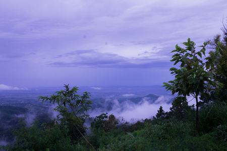 lurid: Clouds float over the mountains after rain.