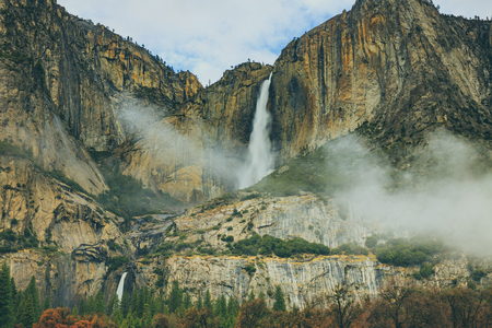 Yosemite Falls, a combination of Upper Yosemite Fall, Middle Cascades, and Lower Yosemite Fall, is the tallest waterfall in North America. Yosemite National Park, California. Stock Photo