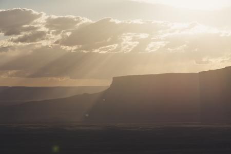 Sunset and sunbeams towards the canyons, Arizona Stock Photo
