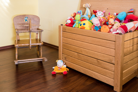 Wooden horse and Soft toy in a childs bedroom