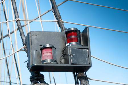 sidelight: Sidelight on an old sailing boat Stock Photo
