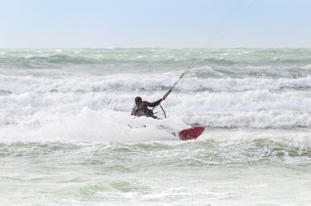 kite surfing: Kite surfer rides among the waves of Northsea, France