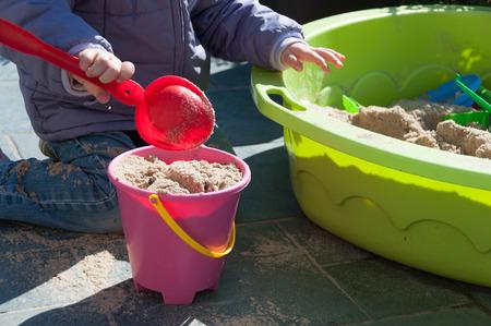 sandbox: Child playing in sandbox