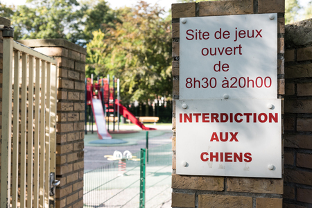 interdiction: Dogs forbidden - Interdiction aux chiens- on a playground in France
