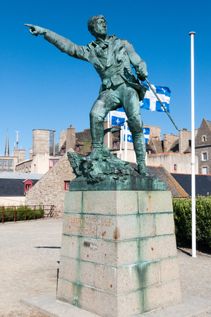 corsair: Robert Surcouf famous French corsair statue in St Malo Brittany France - Famous statue in front of blue sky