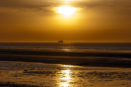 english channel: Ferry boat in the english channel at the sunset Stock Photo