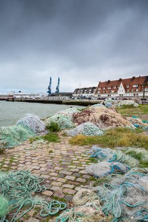 calais: Fishing nets on dock port of Calais, France Stock Photo